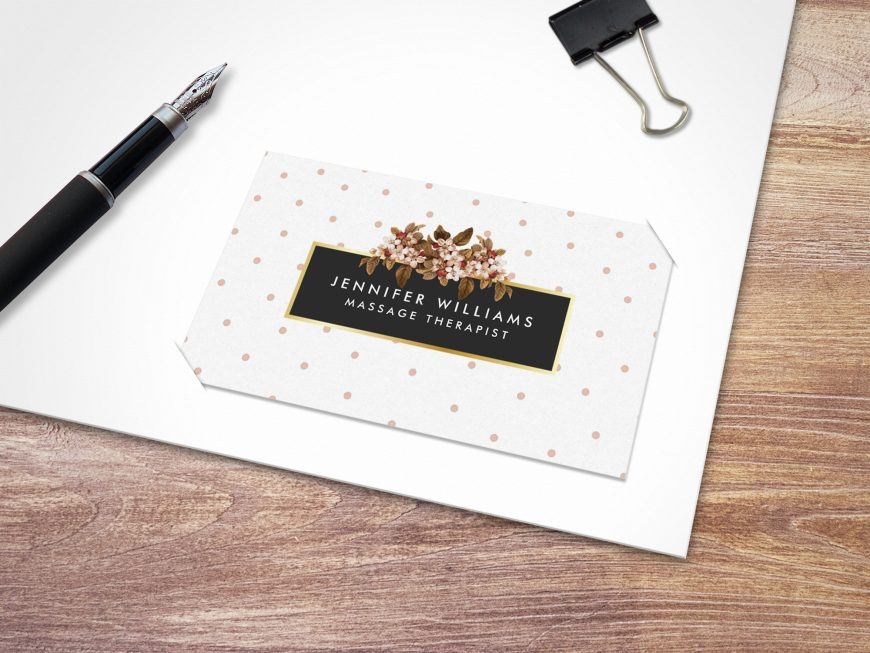 free Business cards mockup with pen and paper clip on wooden background